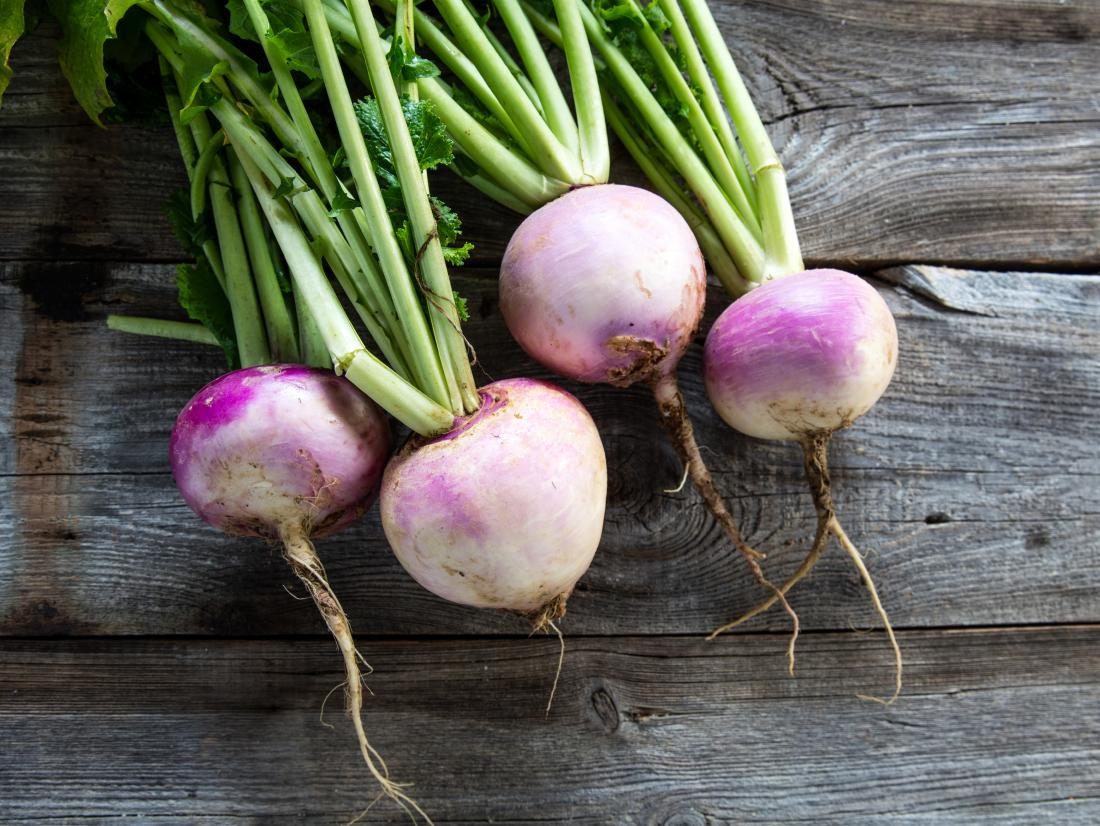 a-bunch-of-turnips-on-a-table